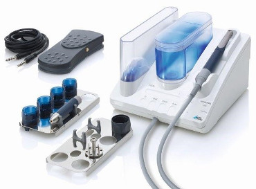 на фото аппарат стоматолога для вектор терапии при лечении и профилактике пародонтоза и пародонтита